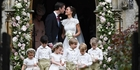 Pippa Middleton and James Matthews kiss after their wedding yesterday. Photo / AP