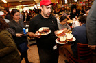 Being expected to tip in restaurants like the Americans do is like having an anti-discount. Photo / AP