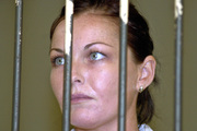 Convicted drug smuggler Schapelle Corby stands behind the bars at court's prison before her appeal trial in Denpasar's court, Bali, Indonesia in 2005. Photo / AP