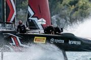 Emirates Team New Zealand, left, sails alongside Groupama Team France. Photo / AP