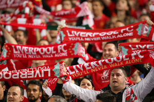 Fans sing before a soccer friendly match between Liverpool FC and Sydney FC in Sydney. Photo / AP