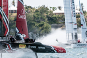 Emirates Team New Zealand, left, sails alongside Groupama Team France, right, during a practice race on Bermuda's Great Sound. Photo / AP