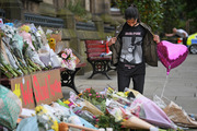 Fans have attended vigils and laid flowers at remembrance sites in Manchester. Photo / Getty Images