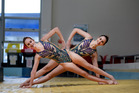 IN SYNCH: Tauranga's international synchronised swimmers Eva Morris, left, and Jazzlee Thomas training in their innovative swimsuits developed by a local artist. PHOTO/GEORGE NOVAK