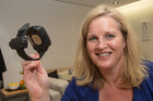 Corrections Minister Louise Upston with an alcohol detection bracelet. Photo  / Mark Mitchell.