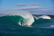 Oscar Smith, of Dunedin, surfs a remote reefbreak near Dunedin. Photo / Derek Morrison