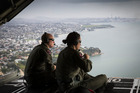 US Coastguard Petty Officers 2nd Class Chris Parmenter and Mandi Stevens take in the spectacular view of Auckland during the exercise. Photo / Greg Bowker