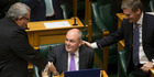 Finance Minister Steven Joyce is congratulated by Prime Minister Bill English and his Cabinet colleagues after reading his Budget 2017 in Parliament. Photo / Mark Mitchell