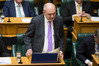 Finance Minister Steven Joyce reading his Budget 2017 in Parliament. Photo / Mark Mitchell
