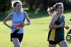 Whanganui High School junior girls winner Rebecca Baker keeps ahead of senior girls winner Caitlyn Alabaster in their combined 3000m race on Thursday.
