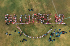 Mount Maunganui College students and staff spell out 'Bully Free NZ' for Pink Shirt Day. Photo/Joe Spiers