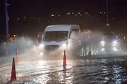 Vehicles on Tamaki Drive make their way through the floodwater as the king tide reached its peak at 8.45pm. Photo / Chris Loufte