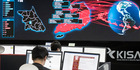 Employees watch electronic boards to monitor possible ransomware cyberattacks at the Korea Internet and Security Agency in Seoul, South Korea. Photo / AP