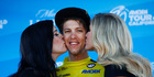 George Bennett, center, of New Zealand, is kissed on the podium after winning the yellow jersey as overall leader, following the sixth stage of the Tour of California. Photo / AP.