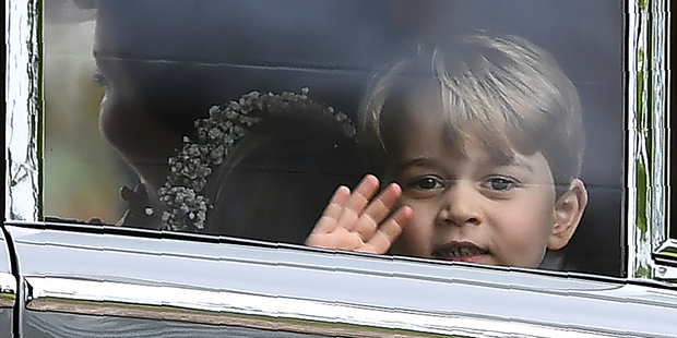 Britain's Prince George waves as he leaves in a car after attending the wedding of his aunt. Photo / AP