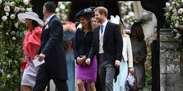 Prince Harry leaves St Mark's Church after the wedding ceremony. Photo / AP