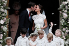 Pippa Middleton and James Matthews kiss after their wedding at St Mark's Church in Englefield. Photo / AP