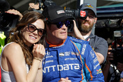 Scott Dixon watches with his wife Emma during qualifications for the Indianapolis 500 IndyCar race at the Indianapolis Speedway hours before he was robbed at gunpoint. Photo / AP