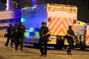 Armed police work at Manchester Arena after reports of an explosion at the venue during an Ariana Grande gig in Manchester. Photo / AP