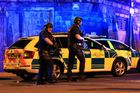 Armed police work at Manchester Arena after this week's explosion. Photo / AP