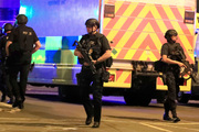 Armed police respond after an explosion at Manchester Arena during an Ariana Grande concert in Manchester. Photo / AP