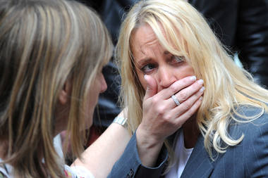 A member of the public reacts as police evacuate the Arndale shopping centre, in Manchester, England. Photo / AP