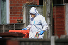 Police forensic investigators search the property of Salmon Abedi in connection with the explosion that took place at the Manchester Arena. Photo / AP