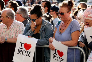 People attend a vigil in Albert Square, Manchester, England. Photo / AP