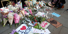 People lay flowers after a vigil in Albert Square, Manchester, England. Photo / AP