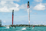 In this photo provided by the America's Cup Event Authority, Emirates Team New Zealand, center, sails alongside Groupama Team France, right, and Land Rover BAR, left.
