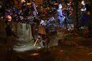 Police officers inspect the site where bombs reportedly went off near a bus terminal in Jakarta, Indonesia. Photo / AP