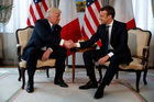 President Donald Trump shakes hands with French President Emmanuel Macron during a meeting at the U.S. Embassy in Brussels. Photo / AP
