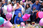 Parents Charlotte Campbell and Paul Hodgson, centre, whose daughter Olivia lost her life this week, mourn outside Manchester Arena. Photo / AP