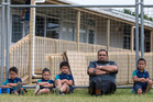 Rowandale School principal Karl Vasau, pictured with Year 1 students outside temporary classrooms under construction in 2015, is praying for new school classrooms in this week's Budget. Photo / File