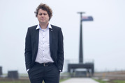 Rocket Lab chief executive Peter Beck in front of the launch tower at Mahia.  Photo / Alan Gibson