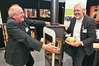 Erich Widmer (left) and EnviroSolve director Dr. Rene Haeberli at the Home and Living show promoting their Bionic Fire, which is also the show's prize. Photo/Warren Buckland.