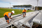 Scaffolders David Junior Makikiriti, left and Sam Leohan installing a temporary grandstand at Toll Stadium in preparation for the upcoming Lions Game to be played at the venue