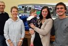 Canvasland's new owners Daniel Taitoko, far right, with partner and co-owner Tamar McKenzie, holding their daughter Willow, and former co-owners Brendan and Sheryl Duffy.