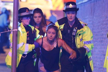 Police and other emergency services are seen near the Manchester Arena after an explosion. Photo / REX