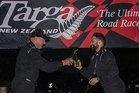 Orewa combination of driver Leigh Hopper (left) and navigator Michael Goudie toast victory in Havelock North village in Hastings last night. Photo/Graham Hughes