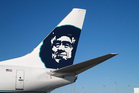 Alaska Airlines'  logo is a smiling old Inupiaq man wearing a fur hood. Photo / Supplied