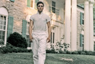 Elvis Presley strolls the grounds of Graceland, in 1957. Photo / Getty Images