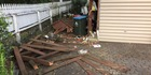 A fence and gate on this Mt Albert property were also destroyed as a wanted man fled police following a carjacking. Photo / Cherie Howie