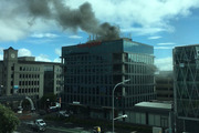 Smoke seen billowing out of the Clearpoint building in downtown Auckland. Photo / Supplied via Matt Turnwald
