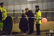Police reassure children traumatised by an explosion at the Manchester Arena. Photo / Cavendish Press
