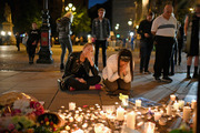 Members of the public attend a candlelit vigil, to honour the victims of the terror attack. Photo / Getty Images