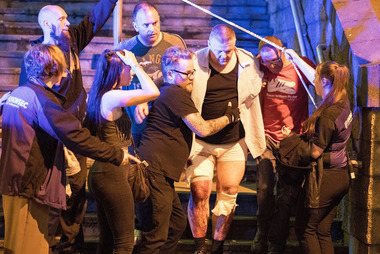 People are seen helping an injured man near Manchester Arena after reports of an explosion at an Ariana Grande concert. Photo / Joel Goodman/LNP/REX/Shutterstock
