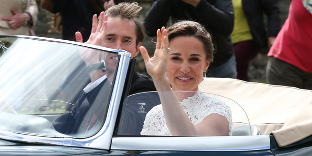 Loading Bride Pippa Middleton and her new husband James Matthews seen leaving St Mark's Church. Photo / Getty Images