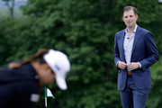 Eric Trump watches on as Lydia Ko putts on a practice green at Trump National golf course. Photo / AP