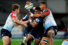 Highlanders wing Waisake Naholo is caught in a high tackle in his team's win over the Waratahs in Dunedin. Photo / Photosport